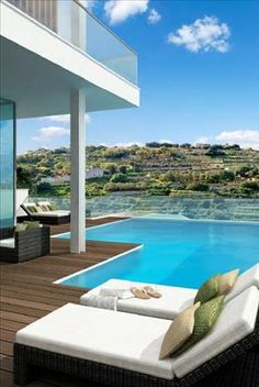 Madliena Ridge, Madliena. A cluster of brand new modern Villas all enjoying incredible sea and valley views. Located in one of, if not the best area of Malta. #Luxury #Villa #Malta #Modern #Seaviews #Country #Views #Landscape #Garden #Pool