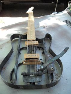 This is an unfinished piece. I still have to clean up some welds and finish a few things, though it is a little further along than this picture shows. Aside from tuning keys and strings, I built ev...