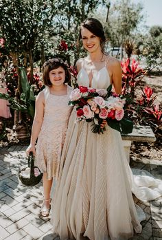 This vintage Carol Hannah wedding dress at a Naples botanical garden wedding has our hearts a-flutter! #vintageweddingdresses #tropicalweddingflowers #mismatchedbridesmaiddresses #carolhannahweddinggowns