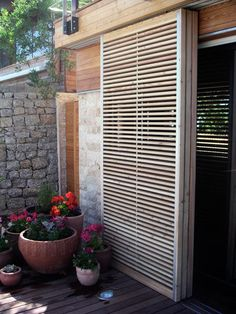 House Key, Cape Town Metal and larch timber sliding shutters by Rivets+Rockets