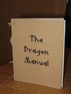 """As one of the party favors, I made miniature """"Dragon Manuals"""" for each child. If you've never seen the movie, the Dragon Manual lists all t..."""