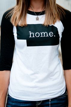 I love it! It'd be cool if the period could be where in Nebraska your home town is. =] I would rock this shirt proudly!