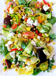 Summer salad with fresh vegetables, goat cheese and a light vinaigrette