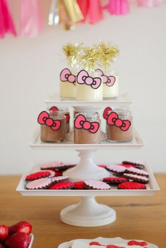 """Whimsical Pots de Crème: """"Instead of putting Hello Kitty's head everywhere, I thought it would be neat to use her iconic tilted bow on the pots de crème jars for the dessert table,"""" mom Gloria says. """"We simply cut out bows and attached them onto the jars.""""  Source: Gloria Wong Design"""
