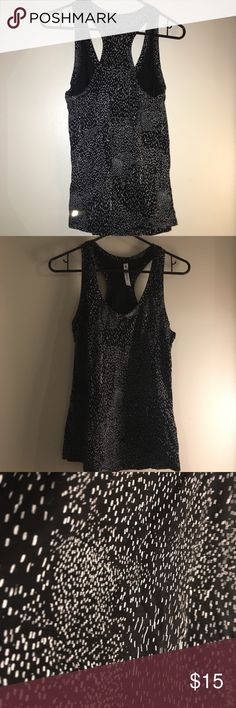 """CLEARANCE!  NWOT Fabletics Top, Black w/white! CLEARANCE!  Last week blow out!  I want everything sold and in the mail by Sunday!  Bundles and offers MORE than welcome!      NWOT Fabletics Top, Black with white splattering!  Size small, brand new.  Enjoy!   Surprise pregnancy blow out! :-) Clearing out space for baby stuff and maternity clothes; bundles and offers welcome!  Like the item but not the price?  Make an offer!  I can't say, """"Yes!"""" if you don't ask! Fabletics Tops"""