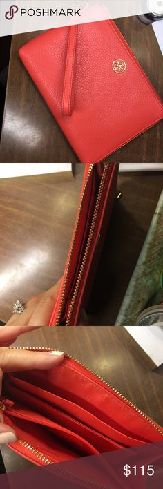 Tory Burch Clutch/Wristlet Used one time, has a small pen mark on the back. My mom gave this to me as a gift and I just done use it enough to keep. The color is a mix between peach/orange Salmon color. Tory Burch Bags Clutches & Wristlets