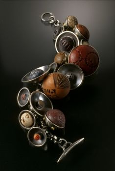 Filapek and Townsend bracelet......CFox: Variety of color, settings, scale, and texture.