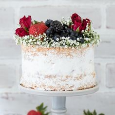 A naked cake featuring 2 layers of vanilla bean cake and a layer of homemade vanilla bean berry ice cream.