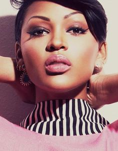 Megan Good uses pink tones on her eyes and cheekbones & top off the look with a soft pink lip