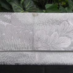 """$60.00 AUD Japanese Vintage Silk Fukuro Obi Clutch Purse.   Created from a vintage (1950's-1980's) 100% silk Fukuro obi.  It features a beautiful design of """"kiku"""" (chrysanthemums) and leaves woven in white and silver foil threads.  The center of the flowers are embroidered in pale gold foil threads."""