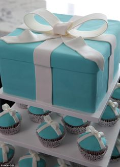 Something blue: blue and white Tiffany & Co. themed wedding cake with matching cupcakes.