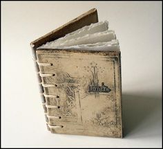 ceramic bookcovers and handmade paper...