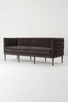I am drooling over this Antropologie tufted sofa. I want this for the library!! $3998.