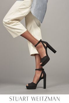 Kick up your heels – and stock up on new ones. The iconic '70s platform receives a sexy, modern twist by way of a fashion-forward stacked heel and chic cutouts, and is handcrafted from the most luxurious materials for a perfect fit. Sophisticated and sleek, this perfect peep-toe sandal is a must-have for every shoe closet. Shop the HIJINX at http://StuartWeitzman.com.