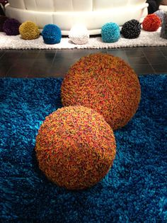 Oversized poufs made out of rubber bands! By Dreamweavers. #hpmkt