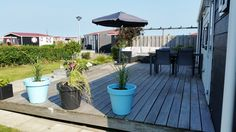 Sonne und Ruhe genießen auf der eigenen Sonnenterrasse im Chaletpark Olmdenduin in Holland