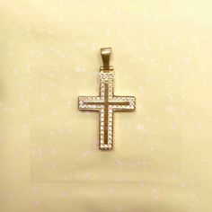 gold cross with stones