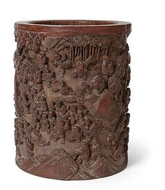 A 'HUNDRED BOYS' BAMBOO BRUSHPOT QING DYNASTY the cylindrical pot carved in deep relief with a continuous scene of boys engaged in various activities in a garden, with a five character signature panel 19cm high, 15.5cm diam