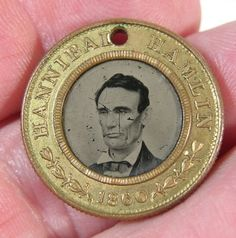 A beautiful example of 1860 Abraham Lincoln / Hannibal Hamlin Ferrotype Presidential Campaign Pin. Photo and name of Lincoln would be on one side, and Hamlin on the reverse. Note that this Pin/Coin has error reversed with photo with Lincoln Ferrotype on the side of Coin that states Hamlin name. Unusual. *s*