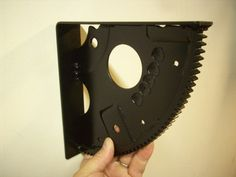 hand-fabricated flywheel shelf brackets made from a recycled flex plate of an automotive transmission