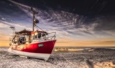 Thorup Strand - Yet another little fishing vessel at Thorup Strand in Denmark.