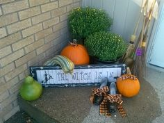 Outdoor Halloween/ Fall Decor Witches brooms, cauldron and witchy shoes complete my cute front porch decorating for Halloween this year! Simple, cute and not overdone! Love it!