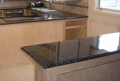 Kitchen Bar Ledge Finished with Deep Blue Pearl Granite  Lazy Tiles and Bullnose