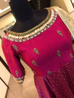 Beautiful rani pink color floor length anarkali dress with jeweler theme. Anarkali dress with hand embroidery kasu and rice pearl work on neckline. 04 April 2018