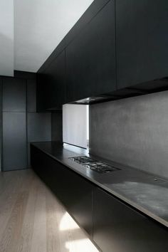 25 Inspiring Black Kitchens for Modern Home Design : Marble Black Kitchen Island With Wooden Floors