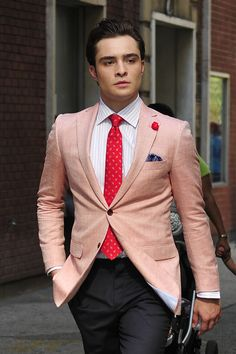 Ed Westwick in light pink blazer and pink tie with contrasting pocket square.