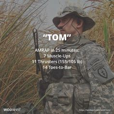 """Tom"" WOD - AMRAP in 25 minutes: 7 Muscle-Ups; 11 Thrusters (155/105 lb); 14 Toes-to-Bar"