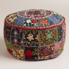 "from WorldMarket.com: Small Black Pouf I want two of these to turn our flat file ""coffee table"" into a tapas-style dining table."