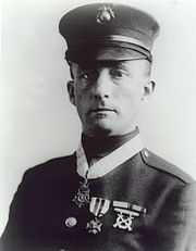 Gunnery Sergeant Ernest Janson saw 12 of the enemy, armed with 5 light machineguns, advancing toward his position. He rushed them, bayoneted the 2 leaders, and forced the others to flee, abandoning their guns. His quick action drove the enemy from a position from which they could have swept the hill with machinegun fire and forced the withdrawal of US troops. June 6, 1918