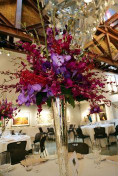 Orchid centerpieces. Wedding reception decor. Party decor. Purple orchids. Mercury glass centerpieces