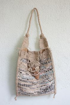 What a stunning shabby handwoven bag!