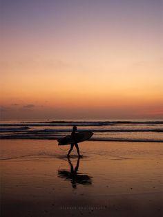 bringing surfboard