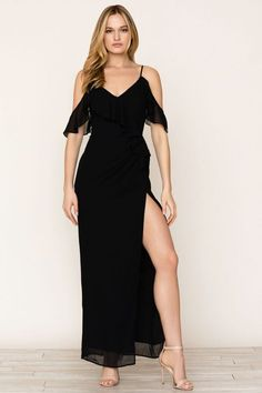 This dress is everything! Details include a ruffle front bodice, adjustable straps, flutter sleeves, high slit, and ruffle sleeve.  #YumiKim #blackdress #style #maxi #dress #fashion.