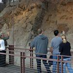 Visitors gaze at the dinosaur bones exposed in the Carnegie Quarry