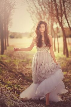 We like beautiful dresses. And what a fairy tale setting! It'd look better if she was looking down, behind, or to the side