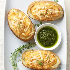 Cheesy twice-baked potatoes are back and better than ever! We've added savory pesto -- mix it in or drizzle it on top for garlicky basil flavor./