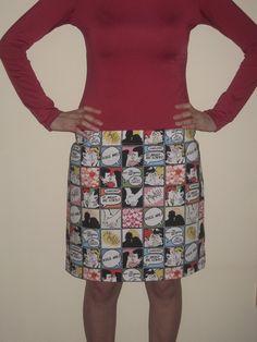 Falda roja con estampado de viñetas de cómic (tela algodón), cintura elástica.