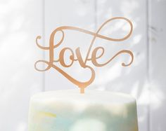 *As featured in 100 Layer Cake!*  This topper is the icing on the cake to your wedding cake!  Laser cut from 1/8 acrylic (or natural birch wood if that is chosen) and finished in black, white, silver or gold. Silver, gold and rose gold are hand-painted by me with the finest paints and sealed with a food safe sealant. All colors are food safe! (Please refer to the last photo in this listing for the color chart!)  Cake topper is about 6 wide and 9 tall from bottom of post to top of design....