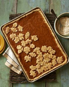Serving a crowd? This pumpkin slab pie with homemade caramel whipped cream is perfect for Thanksgiving and all your holiday parties.