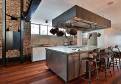 The kitchen is industrial, with stainless steel appliances.