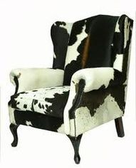 Re-upholster a wing chair in cow hide. Beltie stripe down the middle