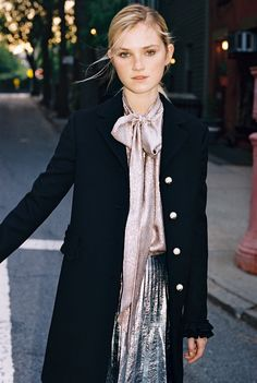 Alexa Reynen, 18, in a Gucci coat with ruche detail and GG pearl buttons, vintage shirt, and Gucci silver leather skirt