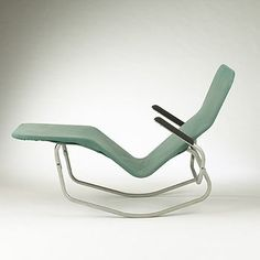 Fantastic 1946 Barwa lounge chair. Rare variation with arms that can be pivoted upward. Edgar Bartolucci Designer