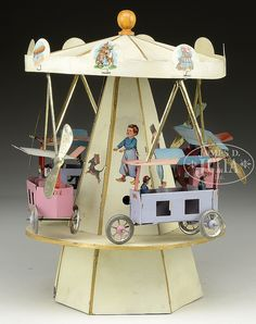 EARLY FLYING WINDUP CAROUSEL.