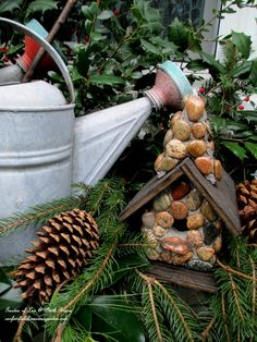 Stone Birdhouse   http://ourfairfieldhomeandgarden.com/rustic-watering-cans-windowboxes-more/