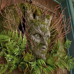 Put visitors face-to-face with their darkest fears. The grim greeter on our    Dark Forest Wreath isn't animated, doesn't speak or make noise,    but his green-eyed stare is enough to chill trick-or-treaters to the bone.    Highly detailed resin face is designed to look like the bark of a tree and    nestled among faux fern, faux succulents, and real moss and twig accents,    for a subtle scare to the unsuspecting (maybe the best kind) fun    way to go ghoulish without going too g...